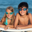 Kids with swimming goggles on the beach — Stock Photo