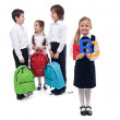 Back to school concept with a group of kids talking — Stock Photo