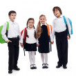 Stock Photo: Group of children holding hands going back to school