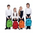 Photo: Group of happy kids with schoolbags - back to school concept