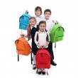 Group of happy kids with colorful school bags — Stock Photo