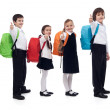 Photo: Back to school concept with happy kids giving thumbs up sign