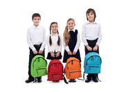 Group of happy kids with schoolbags - back to school concept — Stock Photo