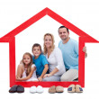 Happy family in their home concept — Stock Photo