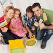 Happy family redecorating their home - painting — Stock Photo #30600433