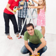 Family repainting their home together — Stock Photo