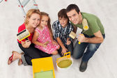 Happy family redecorating their home - painting — Stock Photo