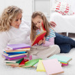 Little girl and woman reading together — Stock Photo #32022567