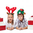Christmas kids with presents and funny hats - isolated — Stock Photo #32022693