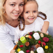 Woman and little girl with advent wreath — Stock Photo