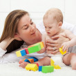 Baby boy playing with colorful blocks — Stock Photo