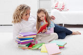 Little girl and woman reading together — Stock Photo