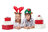 Christmas kids with presents and funny hats - isolated — Stock Photo