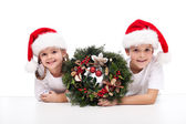 Kids with traditional advent wreath — Stock Photo
