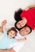Young family with child relaxing — Stock Photo