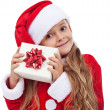 Happy little christmas girl with present — Stok fotoğraf