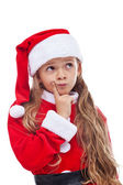 Thinking Santa - little girl in seasonal outfit — Stock Photo