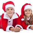Kids in santa costumes at christmas time — Stock Photo