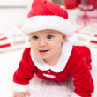 Baby girl in santa outfit crawling — Stock Photo #34497451