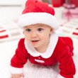 Baby girl in santa outfit crawling — Stockfoto