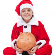 Happy boy in santa costume with piggy bank — Stock Photo