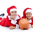 Happy kids saving for the christmas presents — Stok fotoğraf