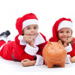 Happy kids saving for the christmas presents — Foto de Stock