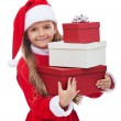 Girl in christmas outfit holding presents — Stock Photo