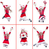 Happy girl with santa costume jumping — Stock Photo