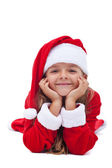 Happy christmas girl propping her head — Stock Photo