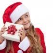 Happy christmas girl checking present — Stock Photo