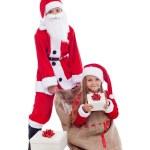Santa with surprise present — Stock Photo