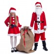 Santa and helper with a large bag of presents — Stock Photo