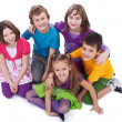 Group of kids sitting on the floor — Stock Photo