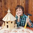Happy boy building an aviary for winter time — Stock Photo