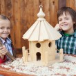 Happy kids building a bird house — Foto Stock