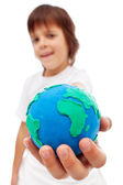 The world in my hand - young boy holding earth globe — Stock Photo