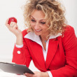 Happy business woman or office worker reading a memo — Stock Photo