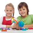 Kids making ecology theme clay figures — Stock Photo