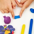 Child hands with colorful clay — Stock Photo