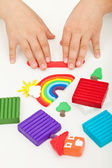 Child hands playing with modeling clay — Stock Photo