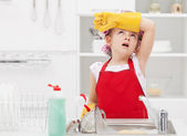 Little housekeeping fairy tired of home chores — Stock Photo