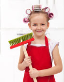 Little housekeeping fairy girl with large hair curls — Stock Photo