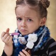 Little girl does not like cough syrup — Stock Photo #38804927
