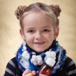 Little girl with medical syrup — Stock Photo #38804943