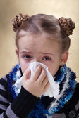 Little girl with the flu blowing her nose — Stock Photo