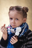 Little girl does not like cough syrup — Stock Photo