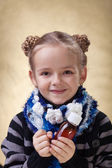 Little girl with medical syrup — Stock Photo
