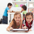Kids playing classic board games and modern tablet computer game — Stock Photo