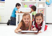 Kids playing classic board games and modern tablet computer game — Foto de Stock